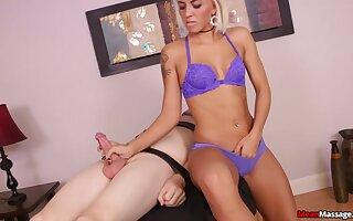 Blonde Blake Carter in purple lingerie tugging one fat joystick