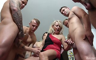 Fat blonde wife Mia drops on her knees to pleasure a lot of dicks