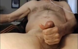 Hairy fat gay jerking on the couch and cums on himself