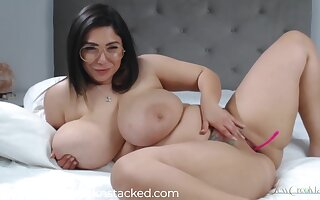 Brunette with ample assets, Creolyta is wearing only glasses while masturbating with a sex toy