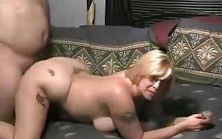 Obedient bulky golden-haired rides strapon